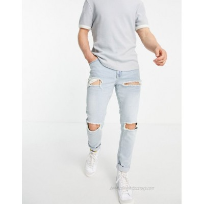 DESIGN skinny jeans with heavy rips in vintage light wash