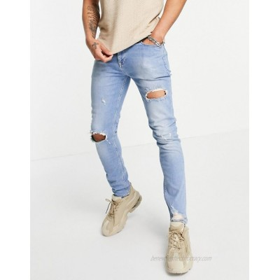 DESIGN skinny jeans in vintage mid blue with knee rip and abrasion