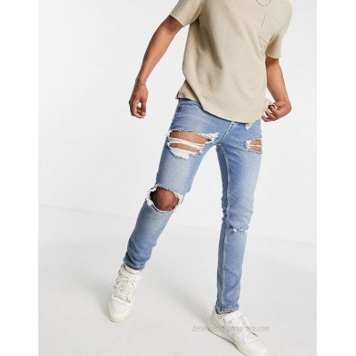 DESIGN skinny jeans with rips and destroyed hem in vintage mid wash blue