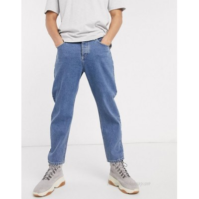 DESIGN relaxed tapered jeans in mid wash blue