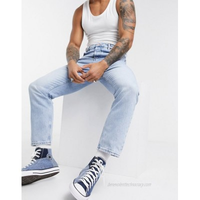 DESIGN relaxed tapered jeans in light blue stone wash