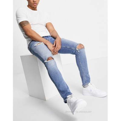 DESIGN skinny jeans with sustainable 'less thirsty' wash in light blue with rips
