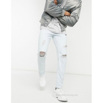 DESIGN stretch slim jeans in flat light wash blue with abrasions and knee rips