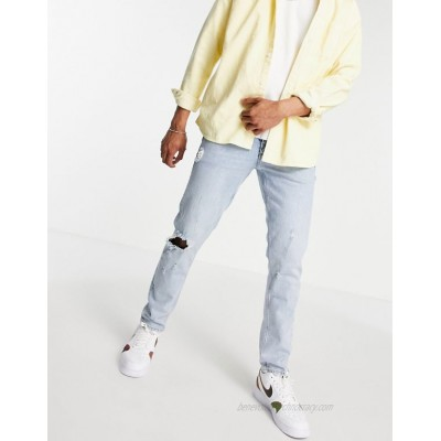 DESIGN stretch slim jeans with rips and abrasions in vintage light wash blue