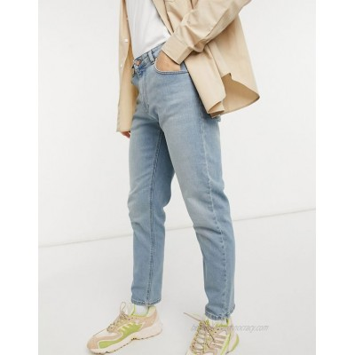 DESIGN stretch tapered jeans in light wash blue